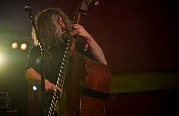 Photo of Eddie Myer playing bass.
